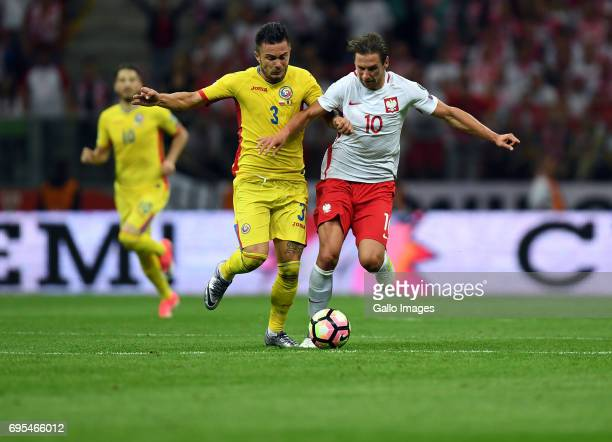 Alin Tosca of Romania and Grzegorz Krychowiak of Poland in action during the 2018 FIFA World Cup Russia eliminations match between Poland and Romania...