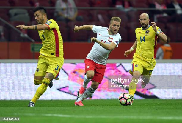 Alin Tosca of Romania Jakub Blaszczykowski of Poland and Iasmin Latovlevici of Romania in action during the 2018 FIFA World Cup Russia eliminations...