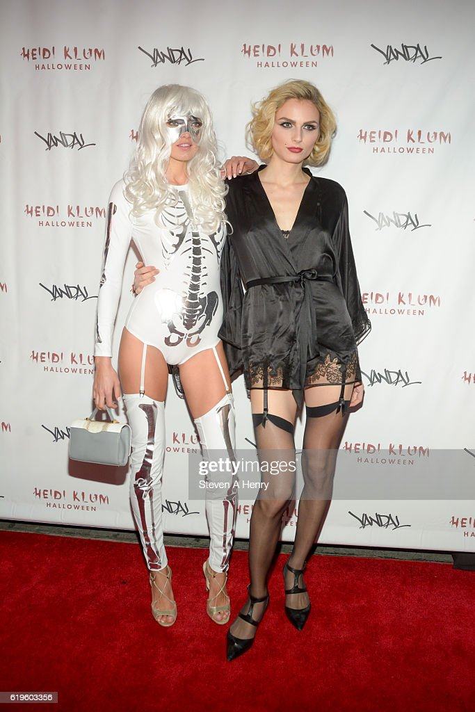 Alina Baikova and Andreja Pejic attend Heidi Klum's 17th Annual Halloween Party at Vandal on October 31, 2016 in New York City.