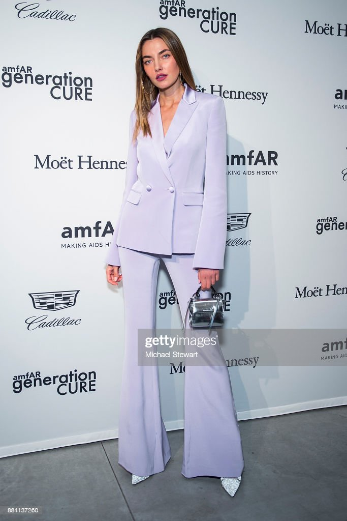 Alina Baikova attends the 2017 amfAR generationCURE holiday party at the Cadillac House on December 1, 2017 in New York City.