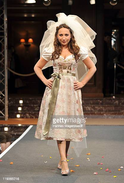 Alina Baumann models for the Julia Trentini Fashion Show at Hotel Vier Jahreszeiten on July 19 2011 in Munich Germany