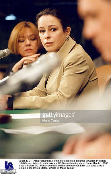 Alina Fernandez center the estranged daughter of Cuban President Fidel Castro listens to testimony at a US Senate hearing about Cuba March 1 2000 in...
