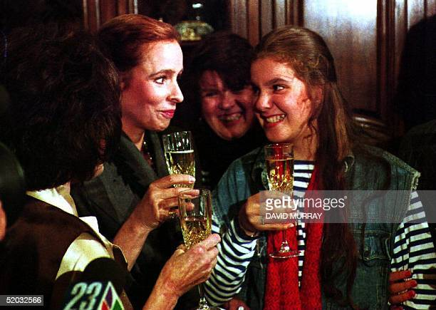 Alina Fernandez Revuelta daughter of Cuban leader Fidel Castro and her daughter AlinaMaria SalgadoFernandez toast the New Year with champagne after...