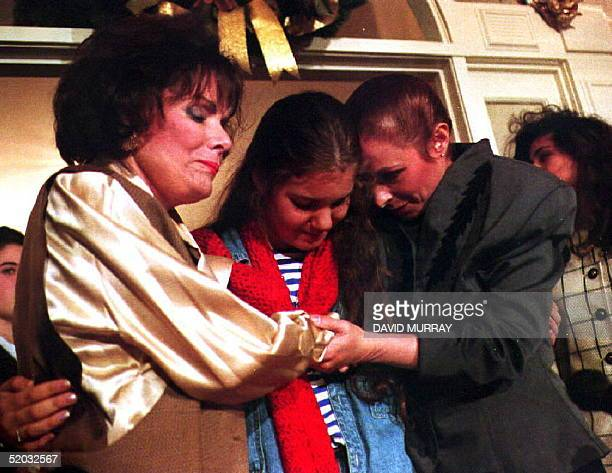 Alina Fernandez Revuelta daughter of Cuban leader Fidel Castro and her daughter AlinaMaria SalgadoFernandez share a moment of thanks with their...