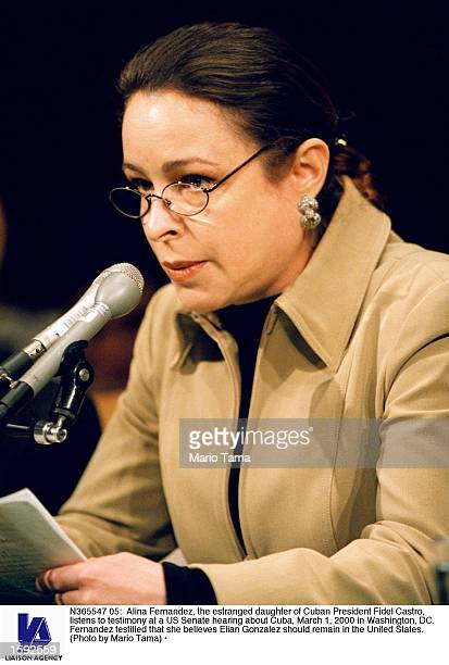 Alina Fernandez the estranged daughter of Cuban President Fidel Castro listens to testimony at a US Senate hearing about Cuba March 1 2000 in...