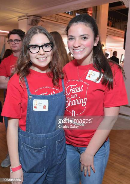 Alina Foley and Eva Bella attend Salvation Army NICKELODEON Feast of Sharing on November 20 2018 in Los Angeles California