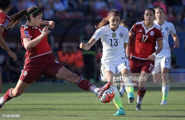 Alina Garciamendez of Mexico blocks the ball against Alex Morgan of USA in the second half of the United States v Mexico: Group A - 2016 CONCACAF...