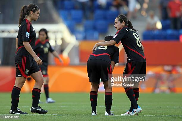 Alina Garciamendez Veronica Perez and Guadalupe Worbis of Mexico look dejected after the 22 draw of the FIFA Women's World Cup 2011 Group B match...