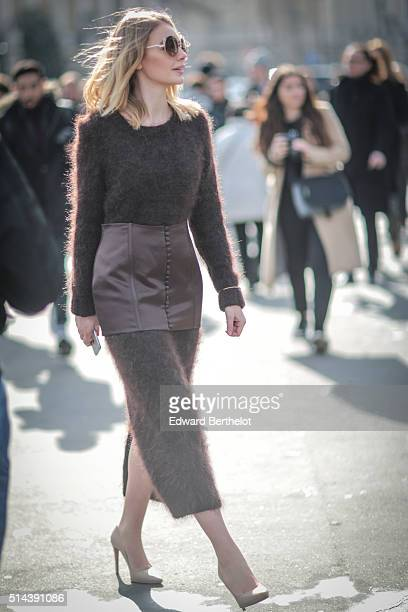 Alina Gelzina is wearing a Bevza brown dress after the Chanel show during Paris Fashion Week Womenswear Fall Winter 2016/2017 on March 8 2016 in...