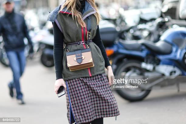 Alina Gelzina wears a Prada bag outside the Miu Miu show during Paris Fashion Week Womenswear Fall/Winter 2017/2018 on March 7 2017 in Paris France