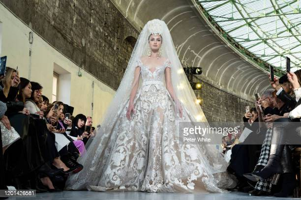 Alina Kozyrka walks the runway during the Elie Saab Haute Couture Spring/Summer 2020 show as part of Paris Fashion Week on January 22, 2020 in Paris,...