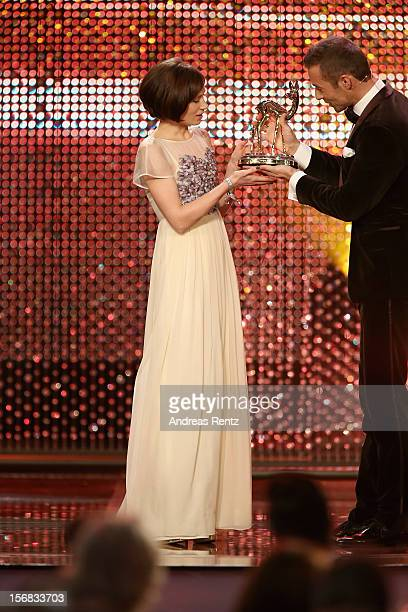 Alina Levshin receives the Bambi award 'Actress National' from Kai Pflaume during the 'BAMBI Awards 2012' at the Stadthalle Duesseldorf on November...