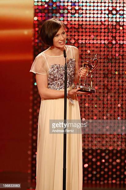 Alina Levshin receives the Bambi award during the 'BAMBI Awards 2012' at the Stadthalle Duesseldorf on November 22 2012 in Duesseldorf Germany