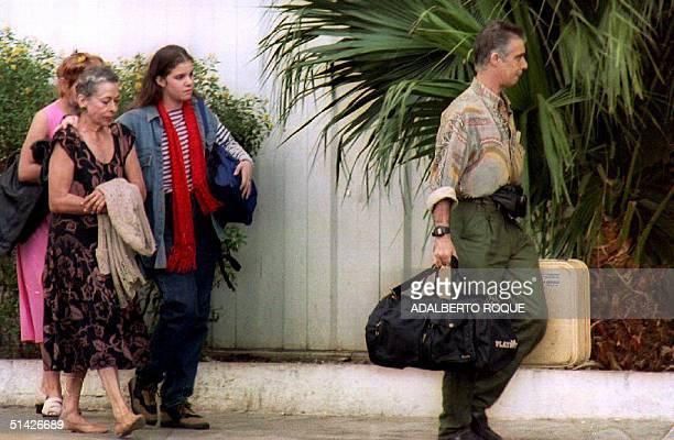 Alina Maria Salgado Fernandez , grandaugther of Cuban President Fidel Castro, walks, 31 December 1993, with her maternal grandmother Natalia Revuelta...
