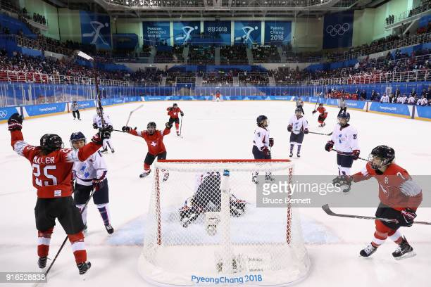 Alina Muller of Switzerland celebrates after scoring a goal against So Jung Shin of Korea in the first period during the Women's Ice Hockey...
