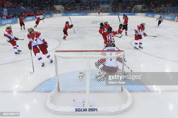 Alina Muller of Switzerland celebrates scoring a goal against Anna Prugova of Russia during the Women's Ice Hockey Playoffs Quarterfinal game on day...