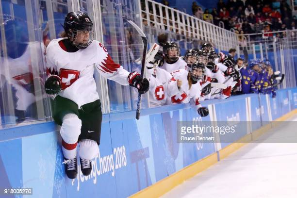 Alina Muller of Switzerland reacts after scoring a goal against Sweden during the Women's Ice Hockey Preliminary Round Group B game on day five of...