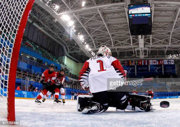 Alina Muller of Switzerland scores a goal against goalie Nana Fujimoto of Japan during the Women's Ice Hockey Preliminary Round Group B game on day...