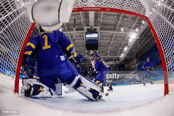 Alina Muller of Switzerland scores against Sweden during the Men's Ice Hockey Preliminary Round Group B game on day five of the PyeongChang 2018...