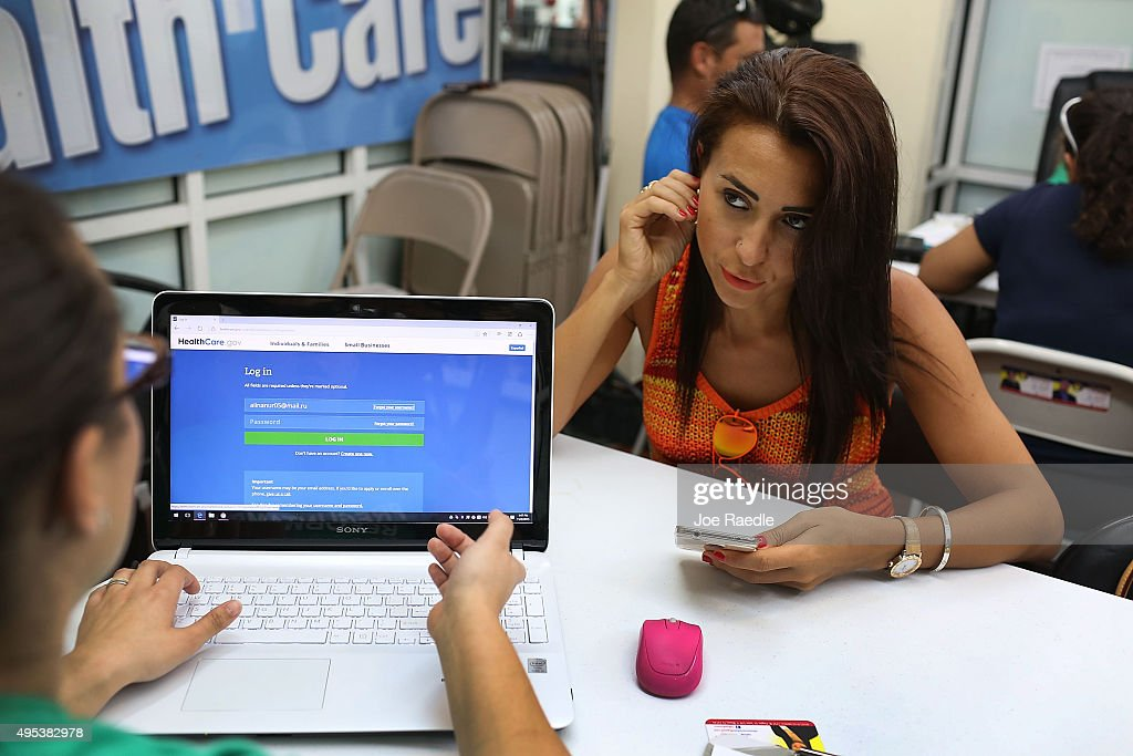 Alina Nurieva (R) sits with Gabriela Cisneros, an insurance agent from Sunshine Life and Health Advisors, as she picks an insurance plan available in the third year of the Affordable Care Act at a store setup in the Mall of the Americas on November 2, 2015 in Miami, Florida. Open Enrollment began yesterday for people to sign up for a 2016 insurance plan through the Affordable Care Act.