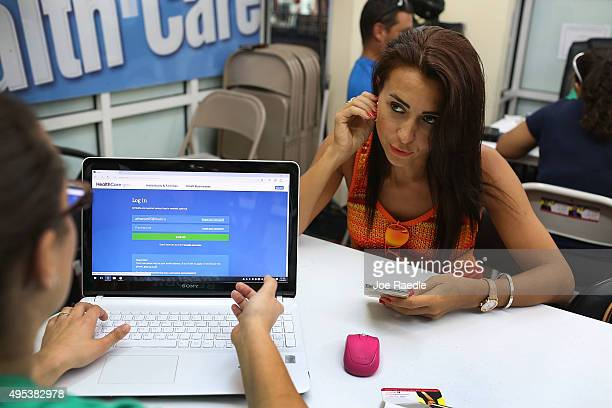 Alina Nurieva sits with Gabriela Cisneros an insurance agent from Sunshine Life and Health Advisors as she picks an insurance plan available in the...