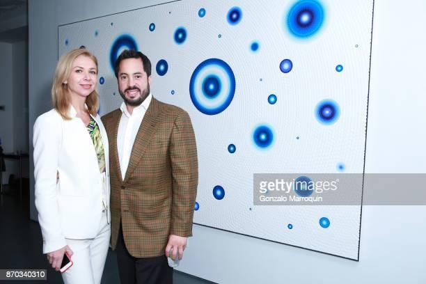 Alina Okshteyn and Ricardo Fernandez during the Ricardo Chavarria by Art Gallery NYC and Overseas Premier Entertainment Corp. On November 4, 2017 in...