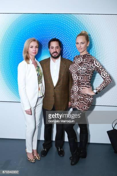 Alina Okshteyn, Ricardo Fernandez and Angelina Shipilina during the Ricardo Chavarria by Art Gallery NYC and Overseas Premier Entertainment Corp. On...