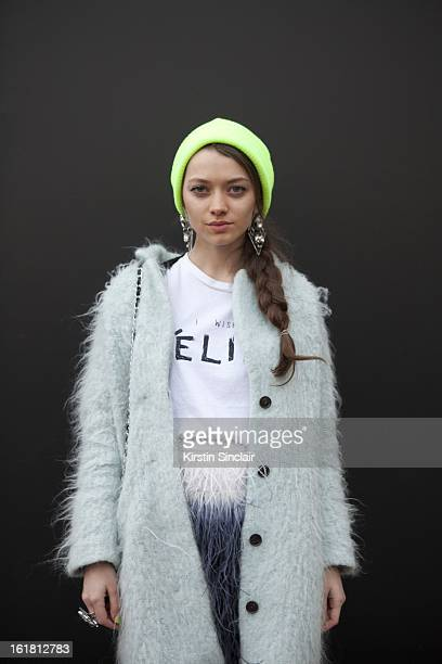 Alina Portnova student wearing H&M Jackket, Top Shop hat and jewelry, Zara dress, on day 2 of London Womens Fashion Week Autumn/Winter 2013 on...