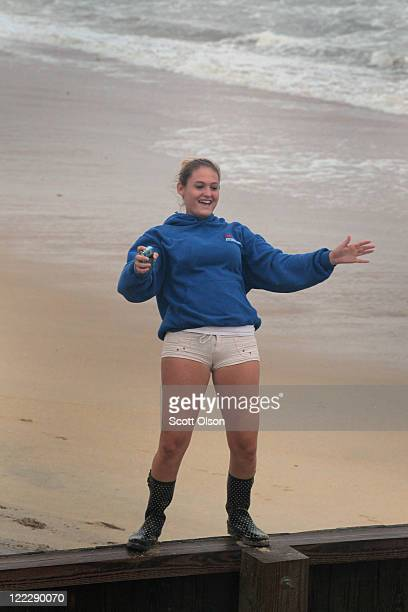 Alina Power tests her ballance while fighting wind from Hurricane Irene while at the beach August 27, 2011 in Kill Devil Hills, North Carolina....