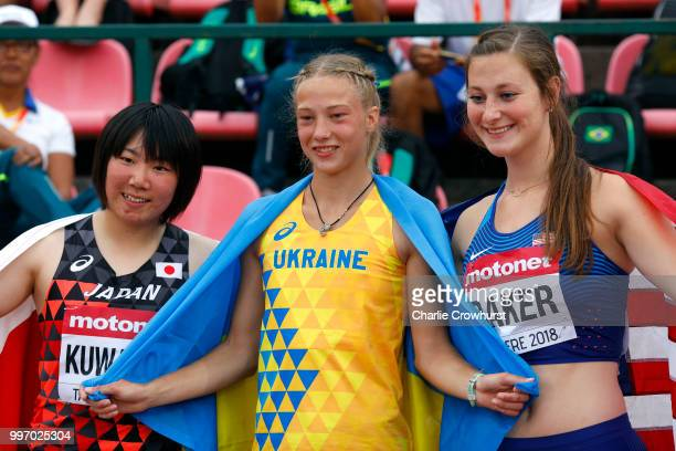 Alina Shukh of Ukraine Took Kuwazoe of Japan and Dana Baker of The USA celebrate their placings in the women's javelin throw on day two of The IAAF...