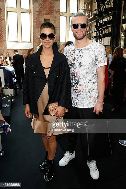 Alina Sueggeler and Andi Weizel attend the Schumacher show during the MercedesBenz Fashion Week Spring/Summer 2015 at Sankt Elisabeth Kirche on July...