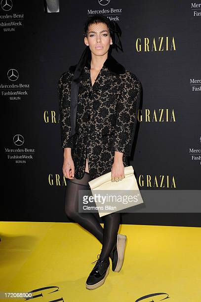 Alina Sueggeler attends the MercedesBenz Fashion Week Berlin Spring/Summer 2014 Preview Show by Grazia at the Brandenburg Gate on July 1 2013 in...