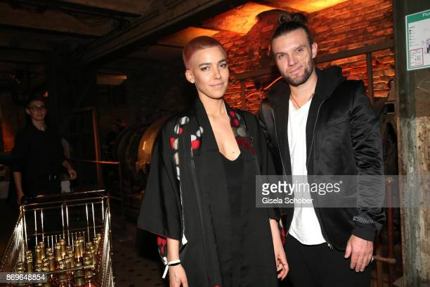 Alina Sueggeler singer of the band 'Frida Gold' and Andi Weizel during the 'When the Ordinary becomes Precious #CartierParty Berlin' at Old Power...