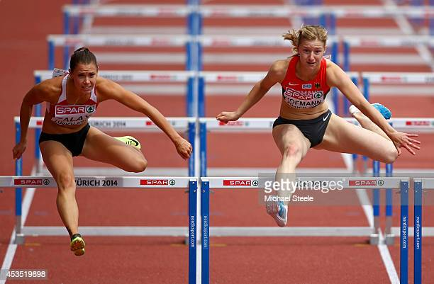 Alina Talay of Belarus and Franziska Hofmann of Germany compete in the Women's 100 metres hurdles heats during day one of the 22nd European Athletics...