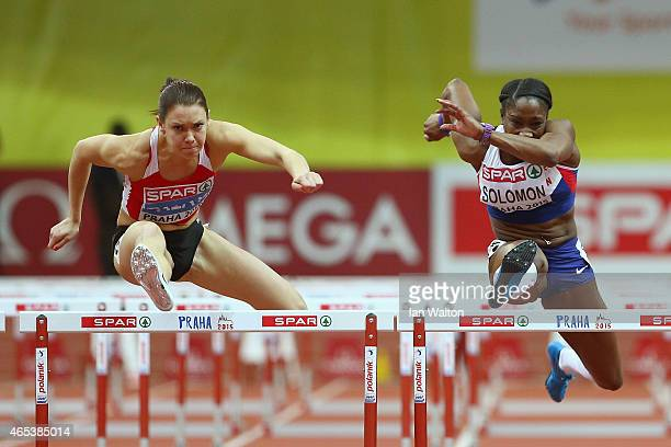Alina Talay of Belarus and Serita Solomon of Great Britain Northen Ireland compete in the Women's 60 metres final during day one of the 2015 European...