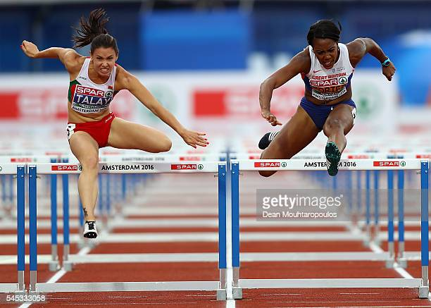 Alina Talay of Belarus and Tiffany Porter of Great Britain in action during the final of the womens 100m hurdles on day two of The 23rd European...