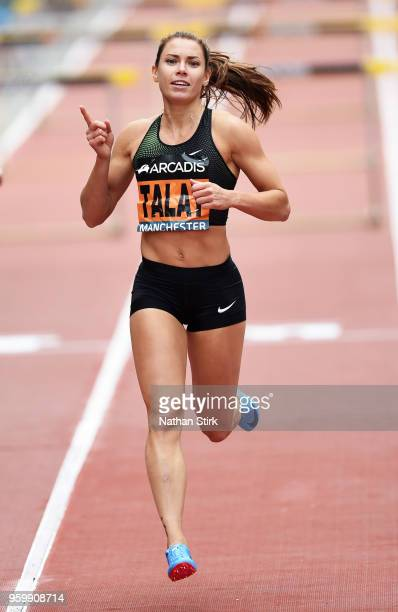 Alina Talay of Belarus celebrates after winning the women's 100 meters hurdles race during the Great City Games on May 18 2018 in Manchester England