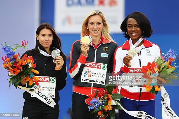 Alina Talay of Belarus Cindy Roleder of Germany and Tiffany Porter of Great Britain pose for pictures after receiving their medals from the womens...