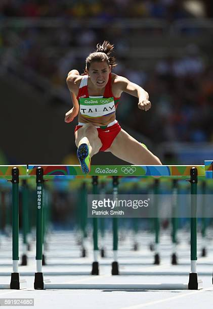Alina Talay of Belarus competes in the Women's 100m Hurdles Round 1 on Day 11 of the Rio 2016 Olympic Games at the Olympic Stadium on August 16 2016...