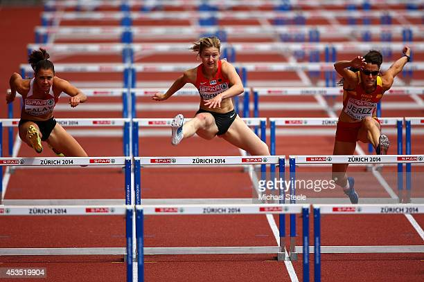 Alina Talay of Belarus Franziska Hofmann of Germany and Caridad Jerez of Spain compete in the Women's 100 metres hurdles heats during day one of the...