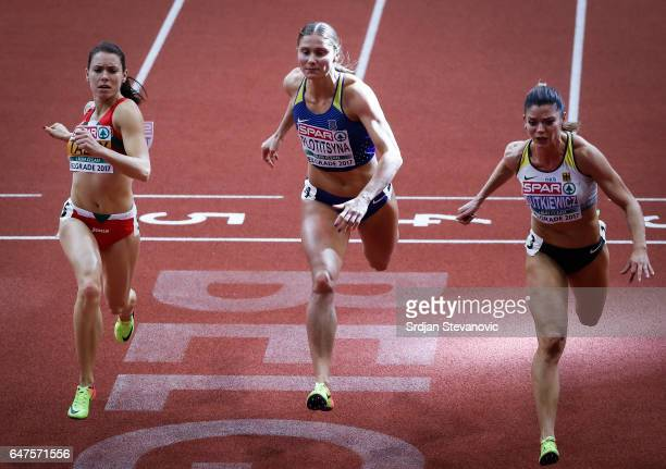 Alina Talay of Belarus Hana Plotitsyna of Ukraine and Pamela Dutkiewicz of Germany competes in the Women's 60 metres hurdles final on day one of the...