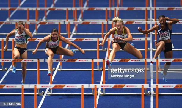 Alina Talay of Belarus Pamela Dutkiewicz of Germany Cindy Roleder of Germany and Solene Ndama of France compete in the Women's 100m Hurdles Final...