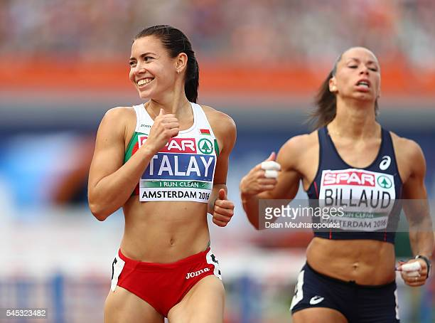 Alina Talay of Belarus smiles after winning her 100m semi final on day two of The 23rd European Athletics Championships at Olympic Stadium on July 7...