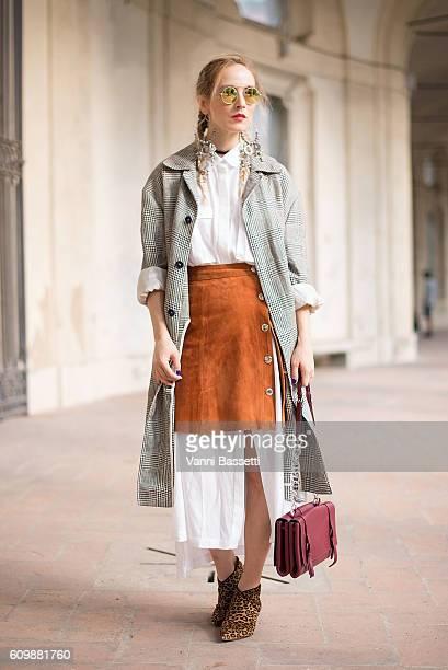 Alina Tanasa poses before the Alberta Ferretti show during Milan Fashion Week Spring/Summer 2017 on September 21, 2016 in Milan, Italy.