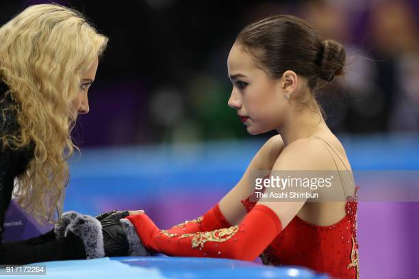 Alina Zagitova of Olympic Athlete from Russia talks with her coach prior to competing in the Figure Skating Team Event Ladies' Single Free Skating on...