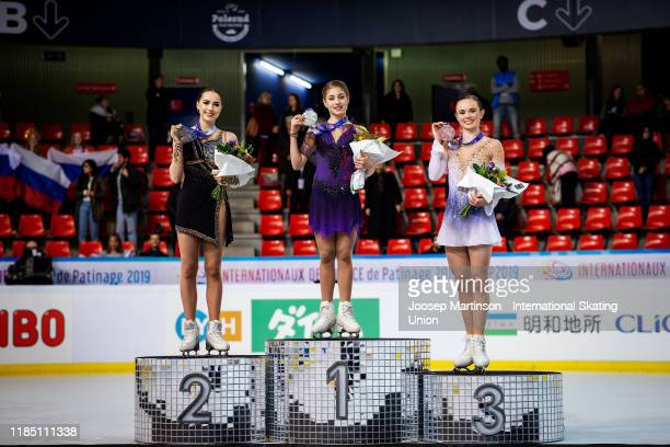 Alina Zagitova of Russia Alena Kostornaia of Russia and Mariah Bell of the United States pose in the Ladies medal ceremony during day 2 of the ISU...