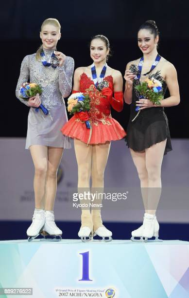 Alina Zagitova of Russia poses for photos after winning the Grand Grand Prix Final figure skating competition in Nagoya on Dec 9 alongside silver...