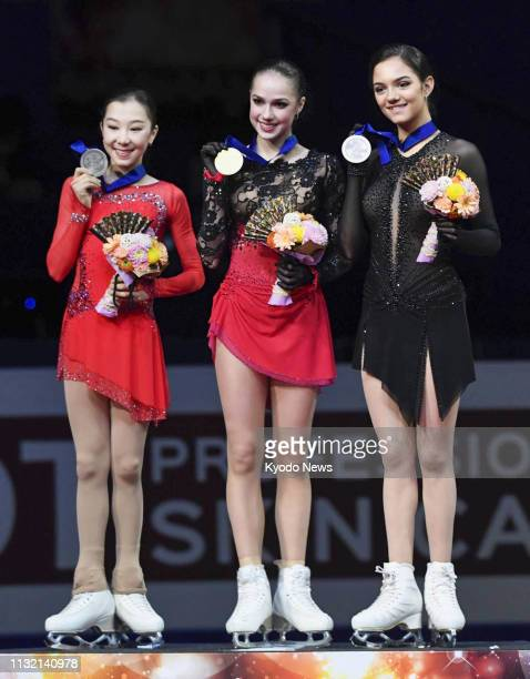 Alina Zagitova of Russia poses for photos after winning the women's event at the world figure skating championships in the Saitama Super Arena near...