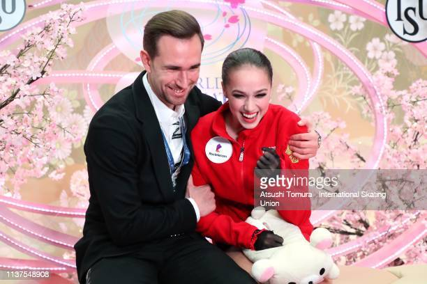 Alina Zagitova of Russia celebrates her score with her coach at the kiss and cry after competIng in the Ladies Free Skating on day three of the 2019...