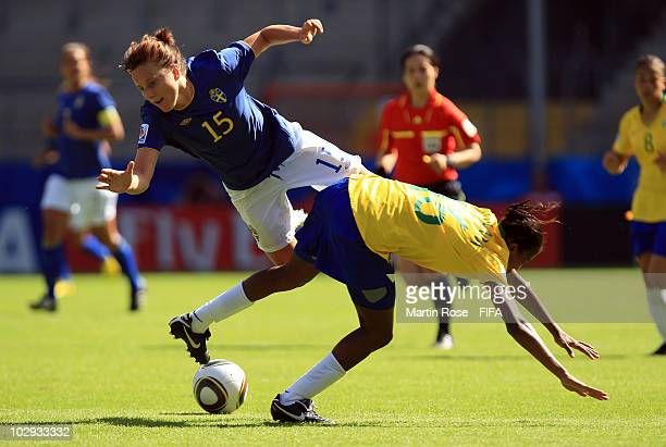 Aline Fernanda R of Brazil and Antonia Goransson L of Sweden compete for the ball during the 2010 FIFA Women's World Cup Group B match between Brazil...